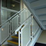 Perforated steel panel balustrades in a new factory's office block.